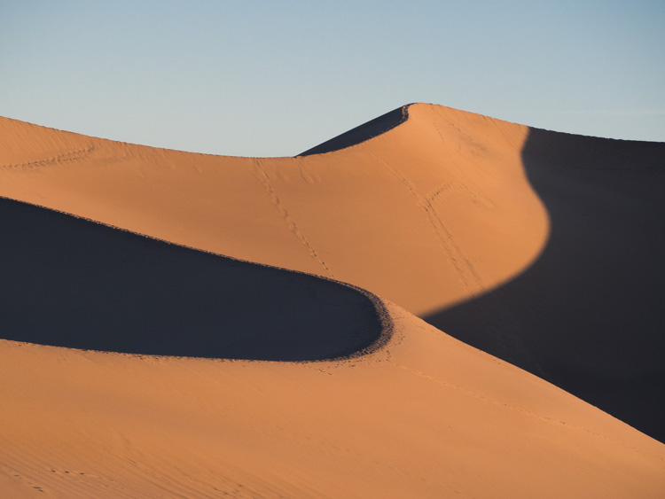 Death Valley Mesquite Dunes at sunrise. sand dunes in shadow