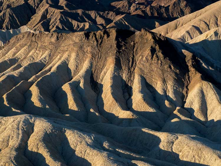 Death Valley National park: Zabriskie point at dawn with shadows