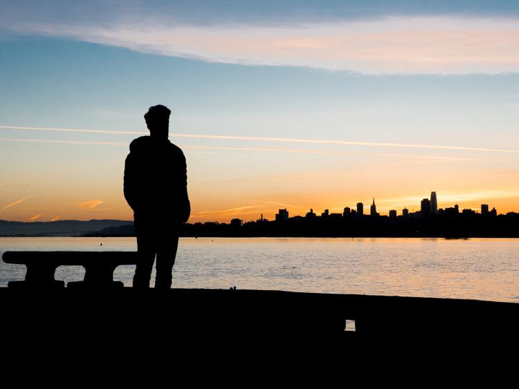 San Francisco Torpedo Wharf at dawn- skyline and man