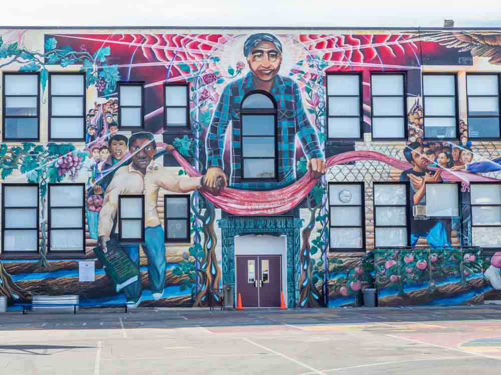 San Francisco Mural: Cesar Chavez Elementary. Man with banner and children doing sign language.