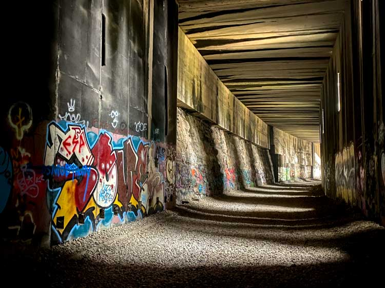 Donner train tunnels #7 with graffiti and light shafts