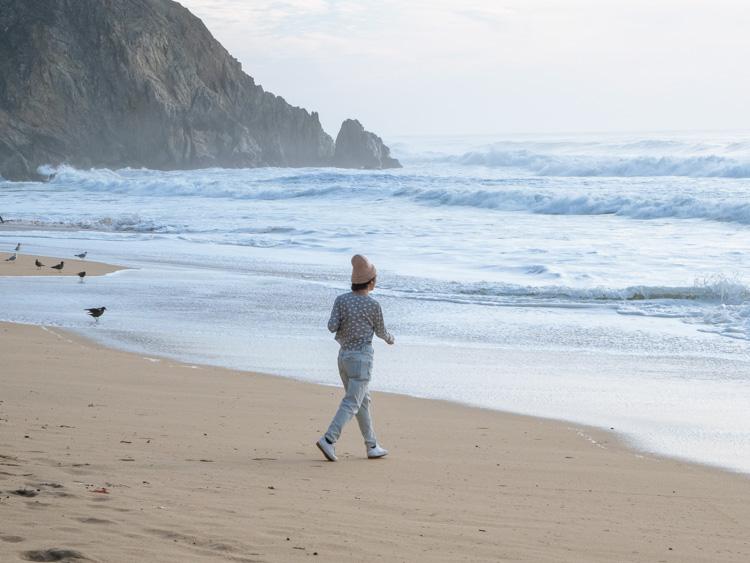 Grey Whale Cove beach woman on beach