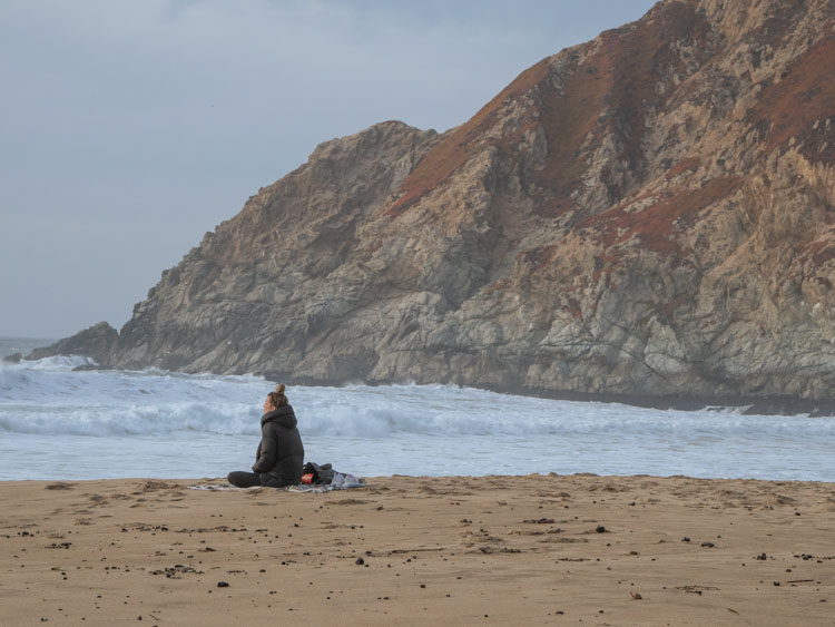 Grey Whale Cove state beach woman chilling on beach