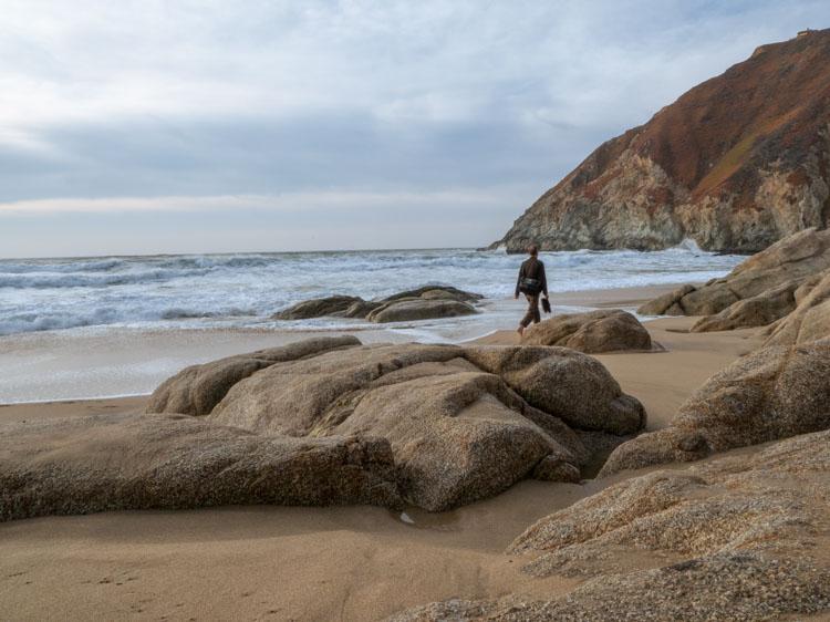 Grey Whale Cove beach rocks and beachcomber
