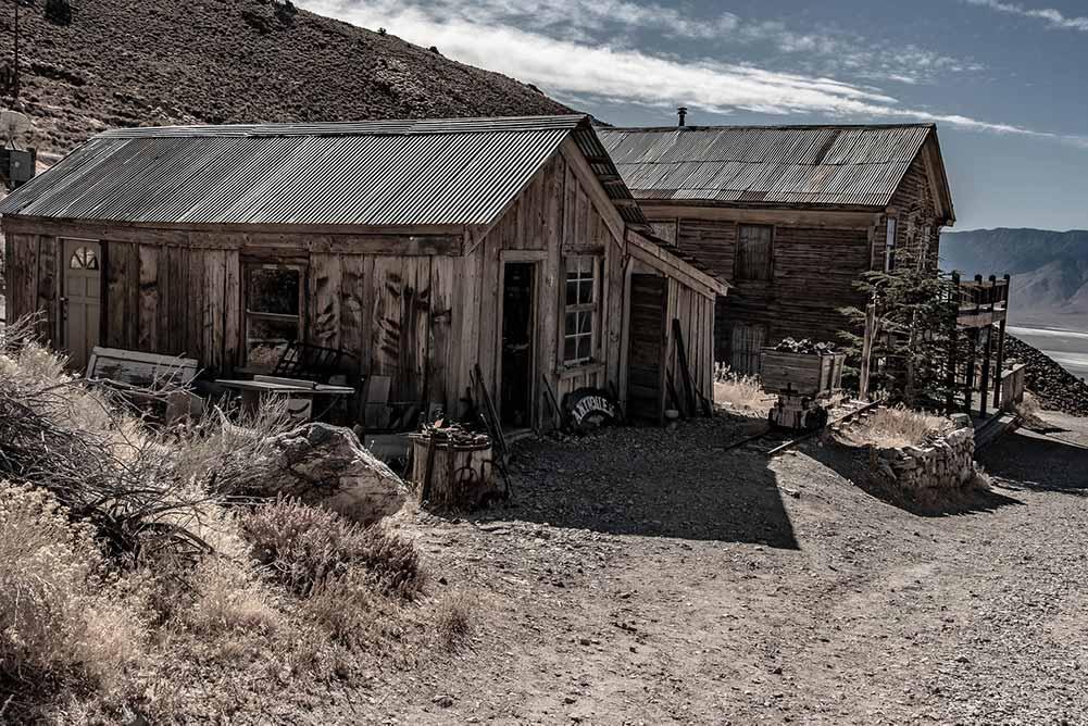 Cerro Gordo mining ghost town in California- old wood buildings