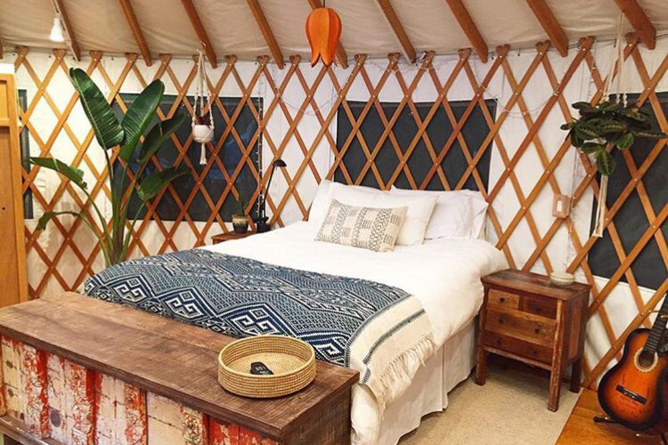Santa Cruz glamping mountain top yurt. bedroom with wood slats