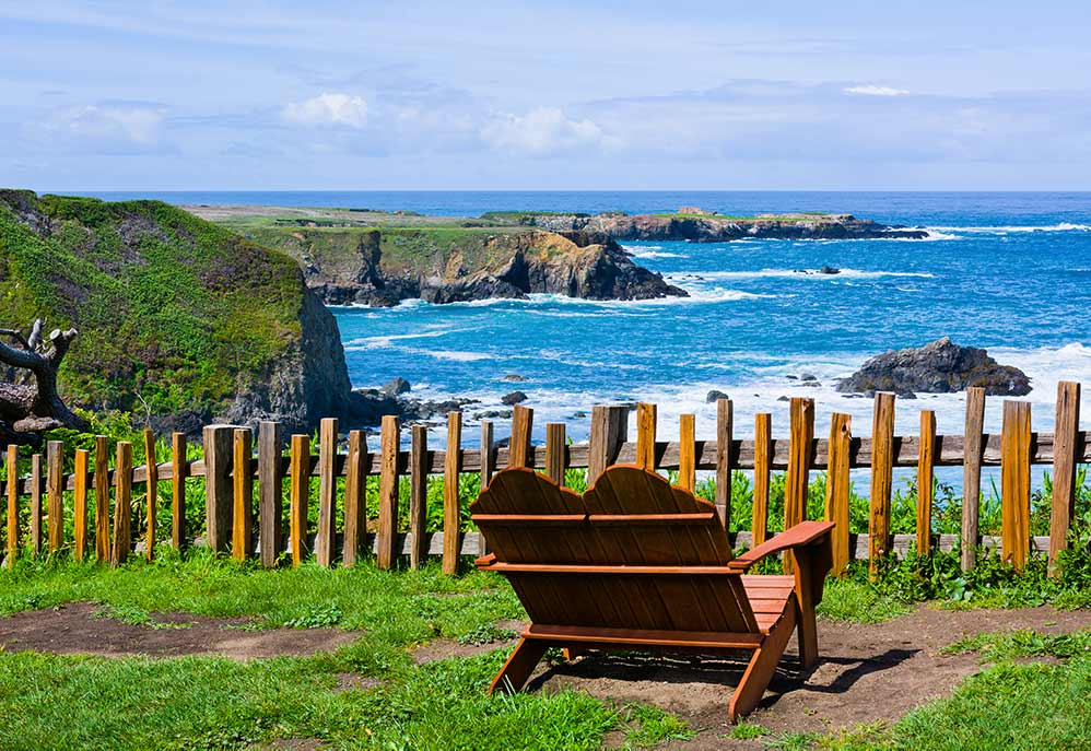 Mendocino coastal view. chair and cliff overlooking ocean