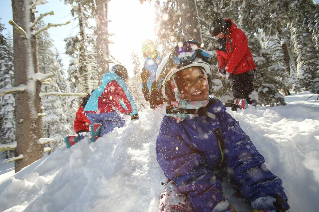 What to pack for Lake Tahoe in the Winter. family playing in snow