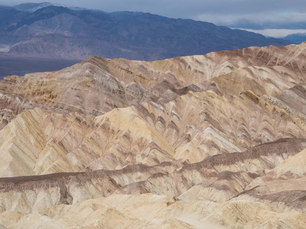 Gower Gulch loop trail death valley. Beige rock landscape and mountains