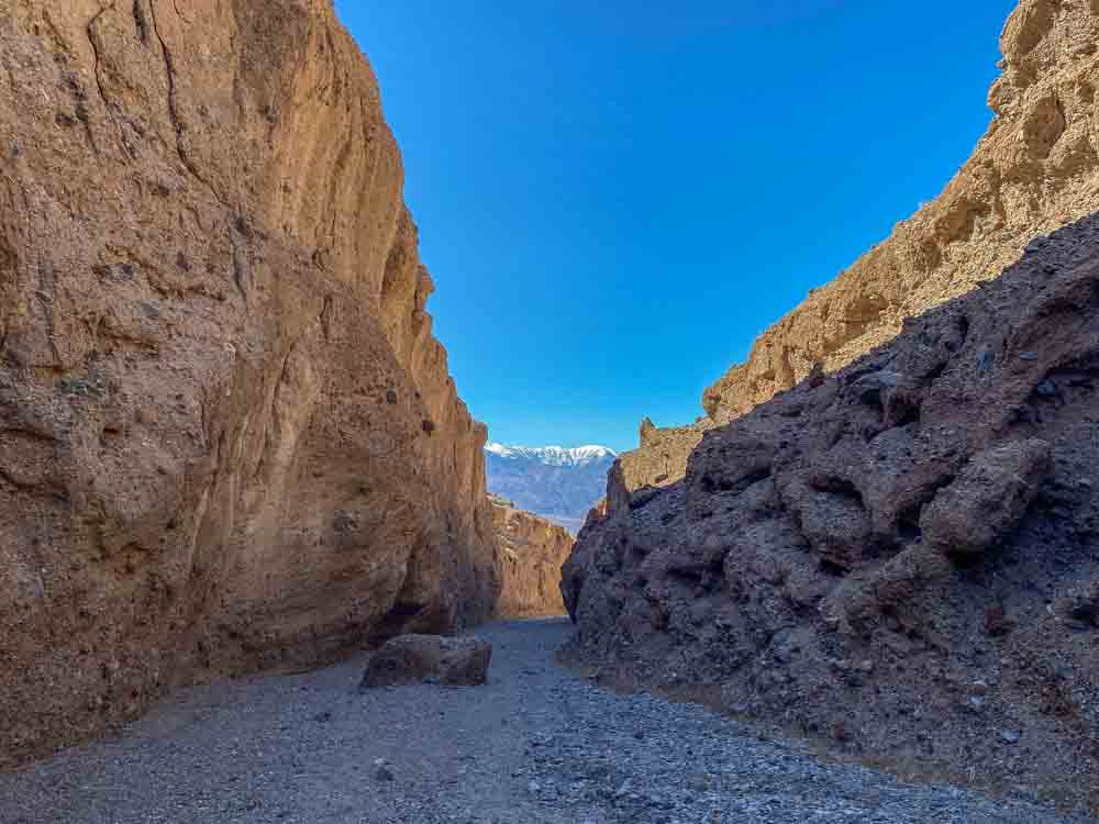 Death Valley Sidewinder Canyon hike. Canyon with shadow and mountains