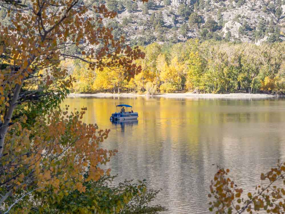 Convict Lake boaters in the fall with turning leaves