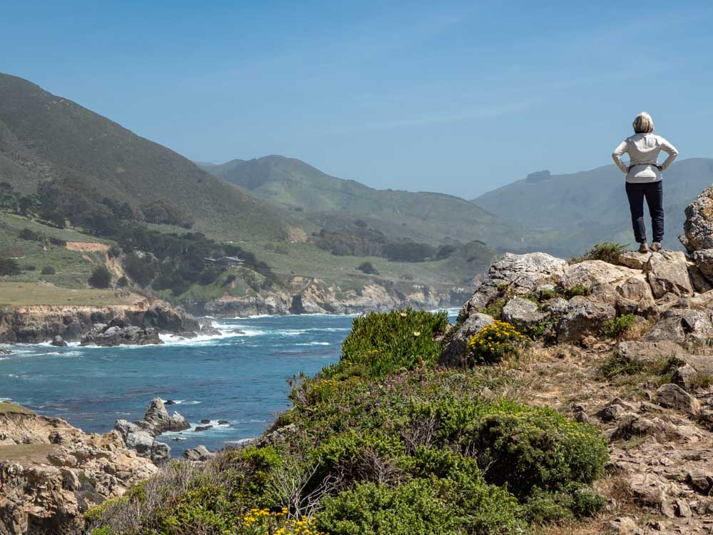 Rocky Point at Big Sur. woman standing on a coastal rock
