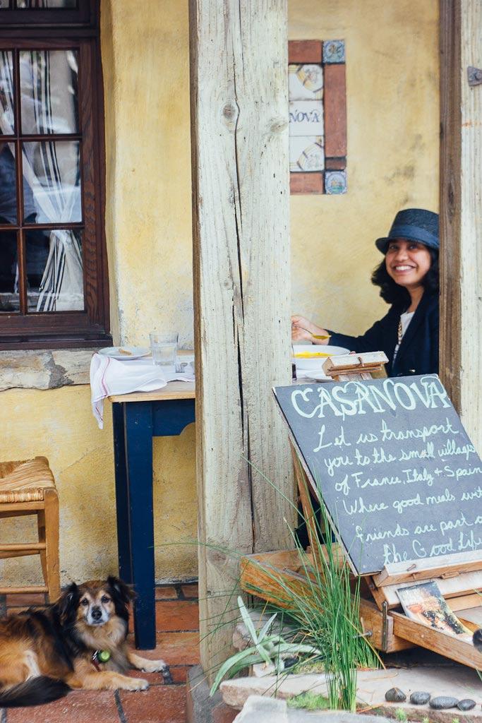 Carmel dining Casanova restaurant. woman and dog on a porch