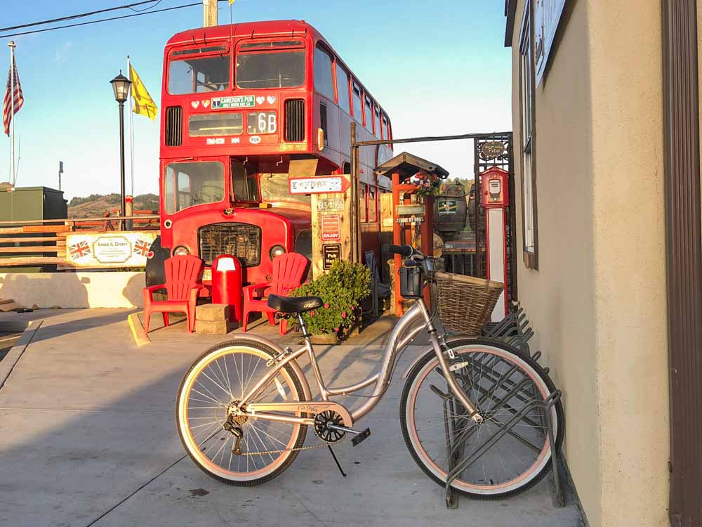 Cameron's pub in Half Moon Bay exterior with red bus and bike