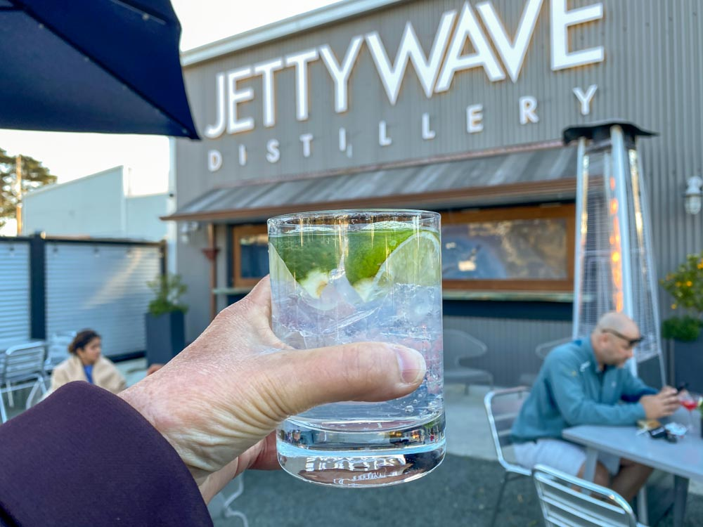 Jettywave distillery in Princeton Harbor. cocktail glass and sign