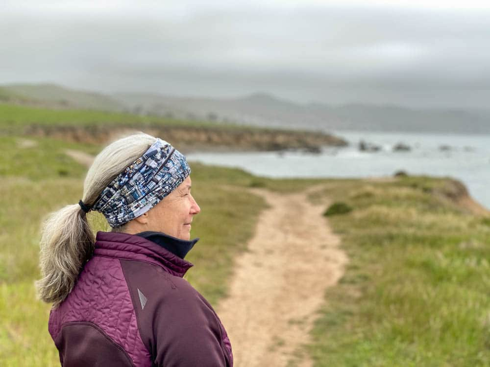Cayucos Estero Bluffs hike. woman looking at ocean