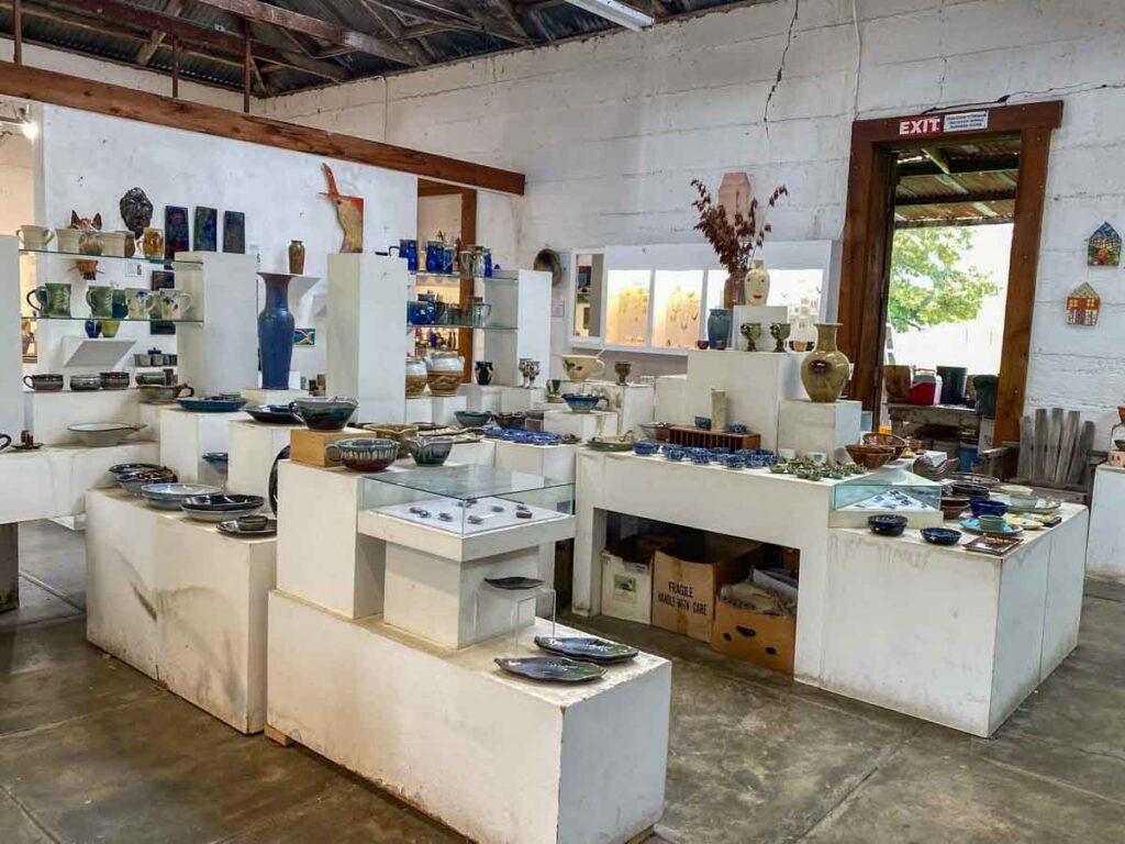 Harmony Pottery Studio- white room with shelves of pottery and ceramics