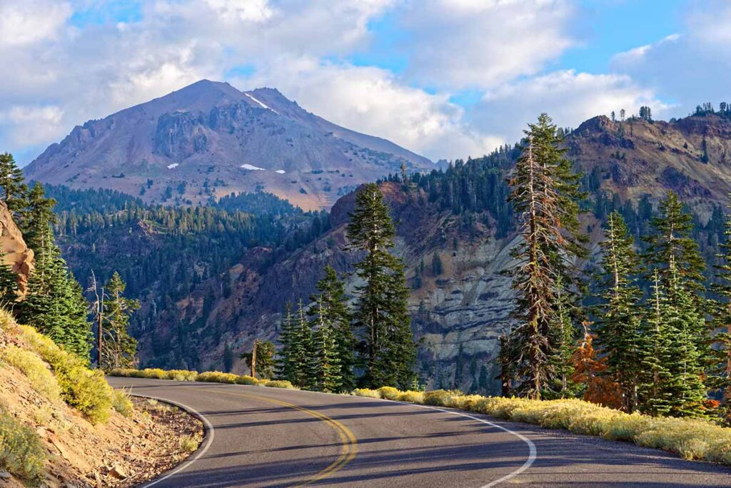 Volcanic Scenic Byway in California: Lassen National Park. highway and mountains