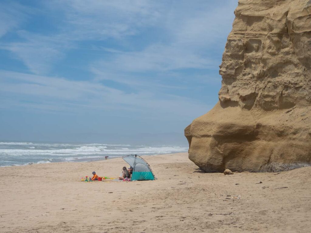 Pomponio Beach in Half Moon Bay. shade tent and family on beach