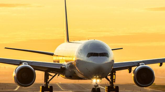 aircraft landing sunset
